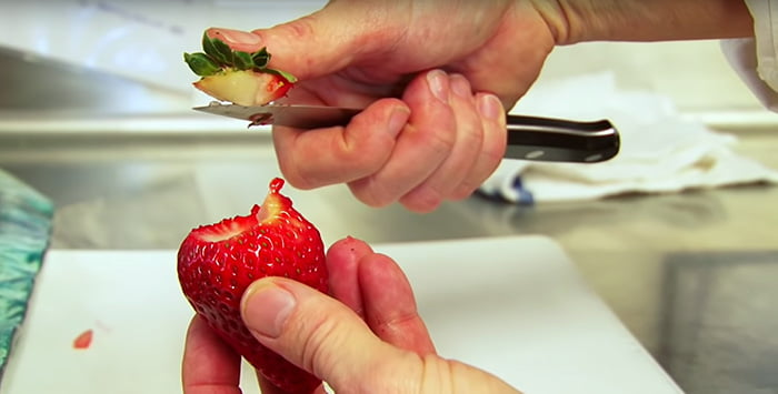 Hulling strawberries with knife