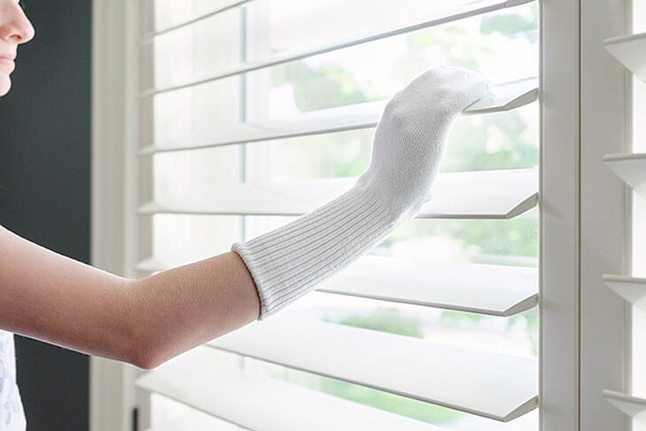 Cleaning blinds with a sock